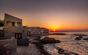 Фотография Рассвет и закат Берег Дома Волны Скалы Солнце Chania Crete
