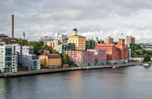 Картинка Швеция Стокгольм Дома Пирсы Водный канал город
