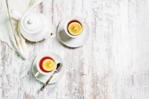 Картинки Чай Лимоны Доски Двое Чашка Ложка Еда
