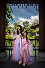 Фотография Азиатка Платья Два Девушки