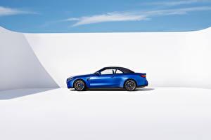 Фотография BMW Синих Металлик Сбоку Кабриолета M4 Competition M xDrive Cabrio, (Worldwide), (G83), 2021 авто