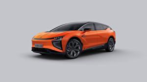 Фотографии Кроссовер Оранжевая Металлик Китайские Серый фон HiPhi X, 2020 авто