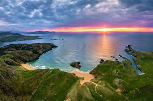 Обои Ирландия Побережье Рассвет и закат Облачно Donegal Природа