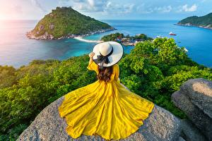 Фотографии Таиланд Море Камни Остров Пейзаж Платье Шляпе Природа Девушки