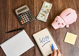 Фотография Доллары Деньги Доски Блокнот Свинья копилка Шариковая ручка