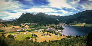 Картинки Норвегия Горы Облака Деревня Grodas Природа