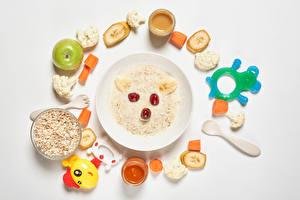 Картинки Каша Креативные Игрушка Яблоки Овощи Фрукты Белом фоне Тарелке Зерно