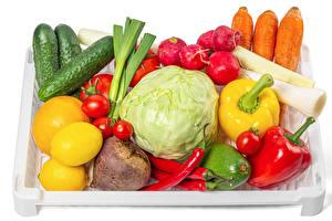 Фотографии Овощи Морковь Редис Огурцы Перец овощной Томаты Лимоны Белый фон Продукты питания