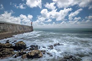 Картинки Франция Берег Маяки Камень Небо Облачно Les Sables-d'Olonne Природа