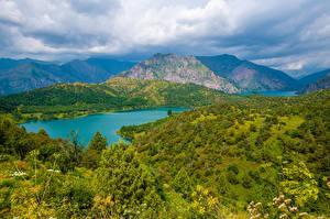 Фотографии Горы Озеро Пейзаж Облака Sary-Chelek Lake, Kyrgyzstan Природа