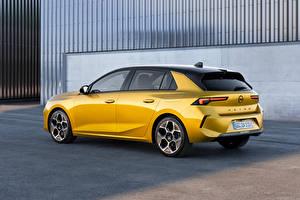 Фотография Opel Желтая Металлик Сбоку Astra Hybrid, (Worldwide), (L), 2021 авто