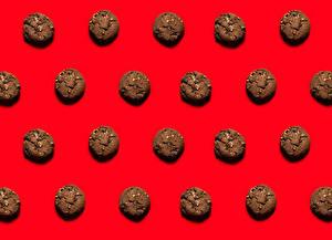 Фотография Выпечка Печенье Текстура Красном фоне Еда