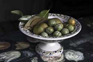 Фотографии Сливы Яблоки Вазы Листья Зеленый Продукты питания