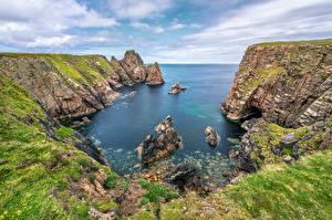 Обои Ирландия Горы Скала Облака Tory Island Природа картинки