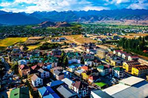 Картинка Горы Дома Облака Bosteri, Kyrgyzstan Города